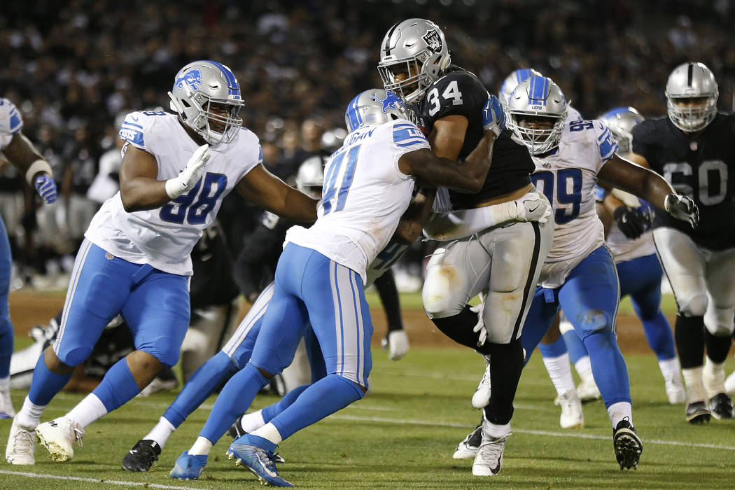 Oakland Raiders running back Chris Warren (34) runs against the Detroit Lions during the second half of an NFL preseason football game in Oakland, Calif., Friday, Aug. 10, 2018. (AP Photo/D. Ross ...