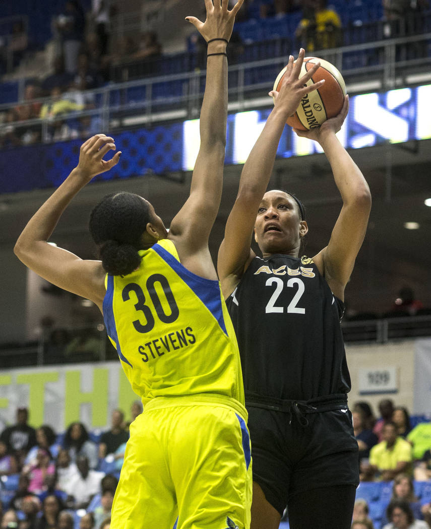 Dallas Wings forward and center Azura Stevens (30) blocks Las Vegas Aces forward A'ja Wilson (22) during the game against the Las Vegas Aces at College Park Center in Arlington, Texas on Aug. 17, ...