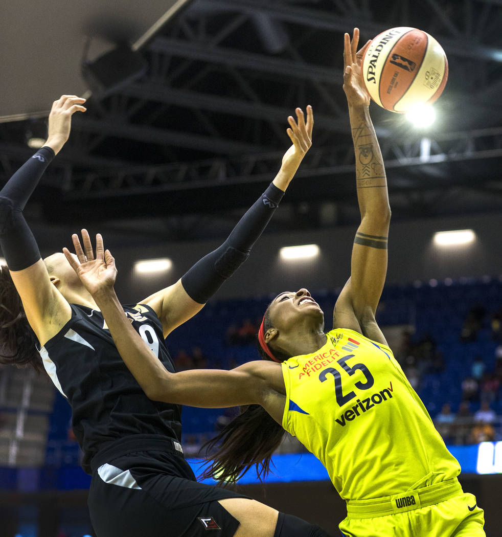 Dallas Wings forward Glory Johnson (25) rebounds the ball as Las Vegas center JiSu Park (19) attempts to block during the game against the Las Vegas Aces at College Park Center in Arlington, Texas ...
