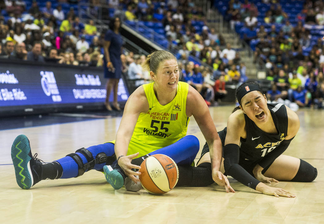 Dallas Wings forward and center Theresa Plaisance (55) blocks the ball from Las Vegas Aces center JiSu Park (19) game against the Las Vegas Aces at College Park Center in Arlington, Texas on Aug. ...