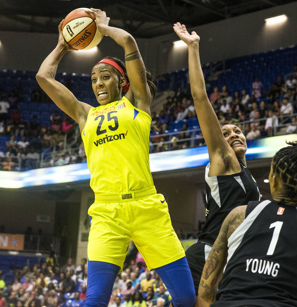 Dallas Wings forward Glory Johnson (25) rebounds the ball during game against the Las Vegas Aces at College Park Center in Arlington, Texas on Aug. 17, 2018. The Wings defeated the Aces, 107-102. ...