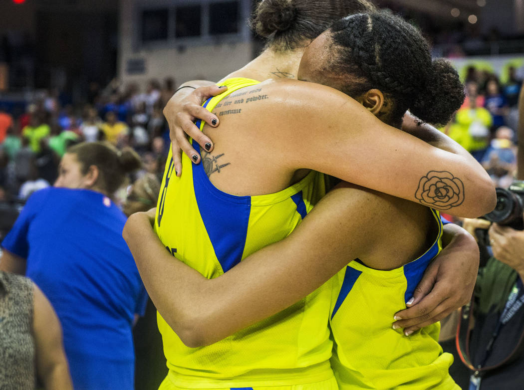 Dallas Wings center Liz Cambage (8), left, embraces forward and center Azur‡ Stevens (30) after the game against the Las Vegas Aces at College Park Center in Arlington, Texas on Aug. 17, 20 ...