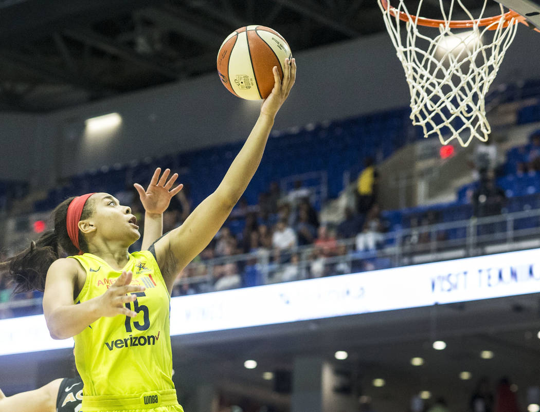 Dallas Wings guard Allisha Gray (15) shoots a basket during the game against the Las Vegas Aces at College Park Center in Arlington, Texas on Aug. 17, 2018. The Wings defeated the Aces, 107-102. ( ...