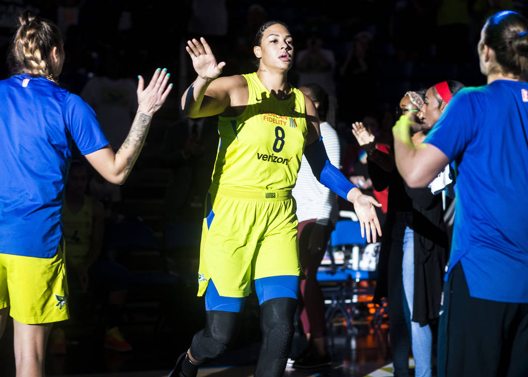 Dallas Wings center Liz Cambage (8) is welcomed on the court before the game against the Las Vegas Aces at College Park Center in Arlington, Texas on Aug. 17, 2018. The Wings defeated the Aces, 10 ...