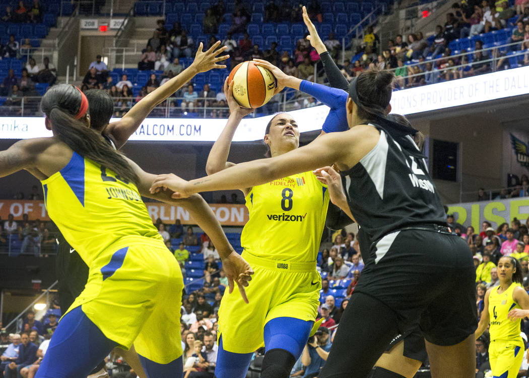 Dallas Wings center Liz Cambage (8) attempts to shoot a basket over Las Vegas forward A'ja Wilson (22) during game against the Las Vegas Aces at College Park Center in Arlington, Texas on Aug. 17, ...