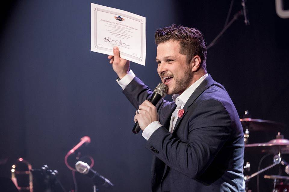 Mark Shunock shows off his one-night-stay certificate for Wild Wild West at The Space on Monday, March 19, 2018. (Mondays Dark)
