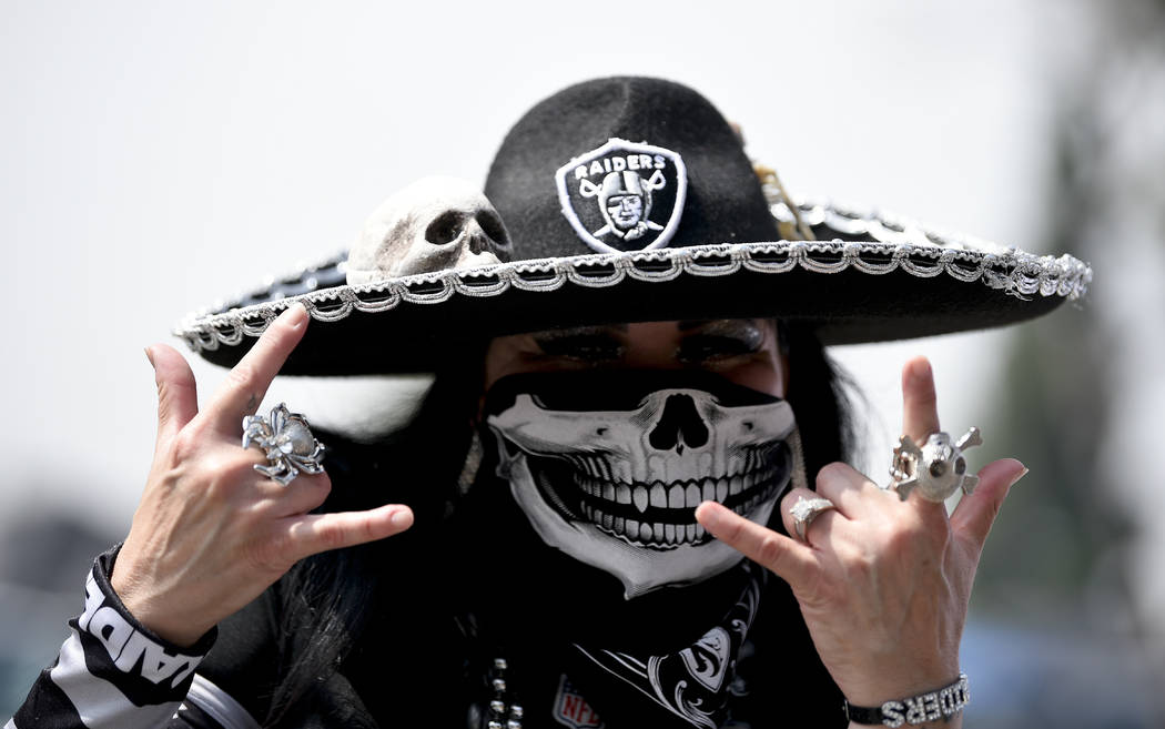 A Oakland Raider fan poses before an NFL preseason football game against the Los Angeles Rams Saturday, Aug. 18, 2018, in Los Angeles. (AP Photo/Kelvin Kuo)