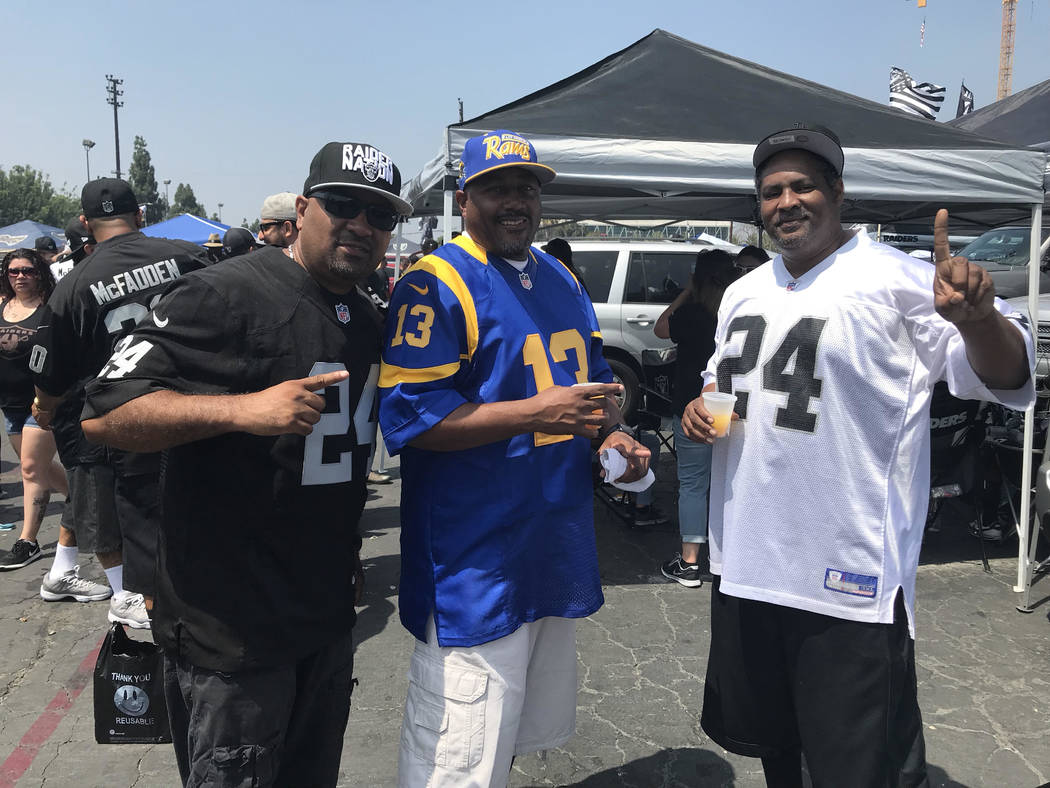 Benard Young (right) and friends tailgate before Raiders-Rams game in Los Angeles on Saturday. (Gilbert Manzano)