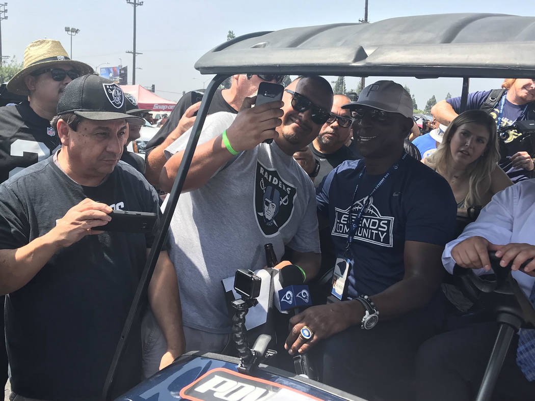 Rams legend Eric Dickerson takes picture with Raiders fans on Saturday. (Gilbert Manzano)