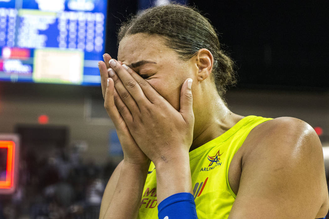 Dallas Wings center Liz Cambage (8) cries after the game against the Las Vegas Aces at College Park Center in Arlington, Texas on Aug. 17, 2018. The Wings defeated the Aces, 107-102. (Carly Geraci ...