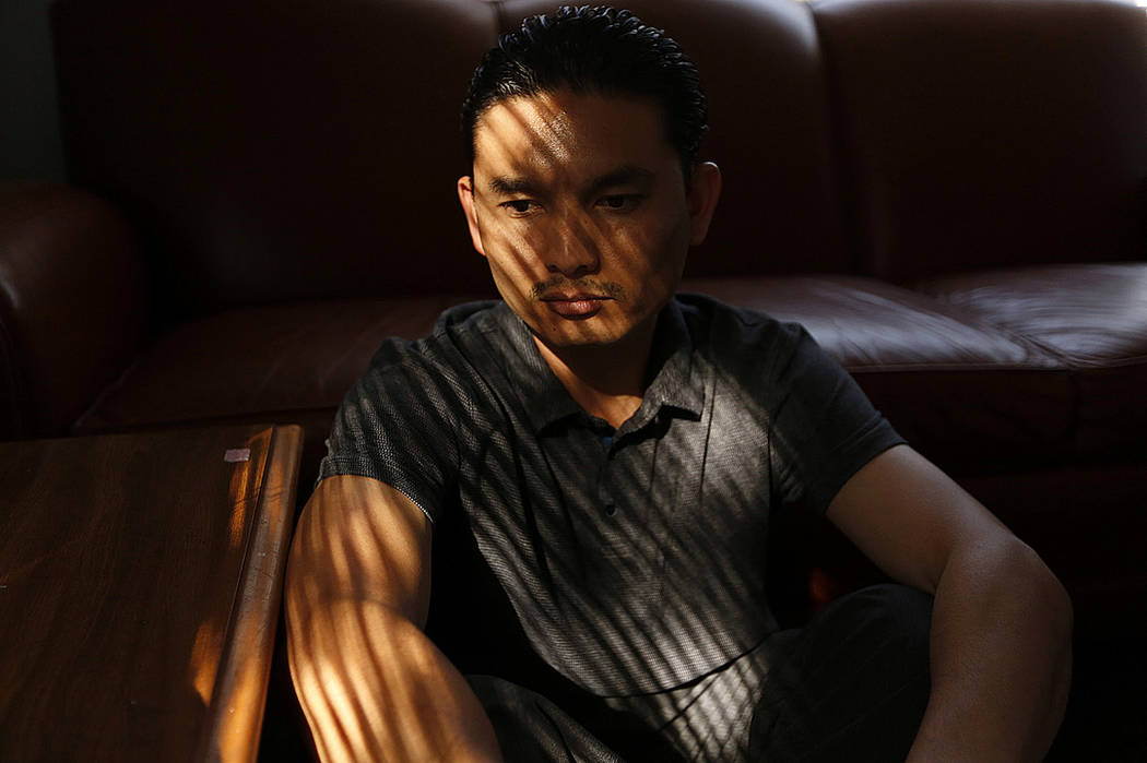 Phal Sok sits in a transitional house where he currently lives in Los Angeles in 2017. (Genaro Molina /Los Angeles Times via AP)