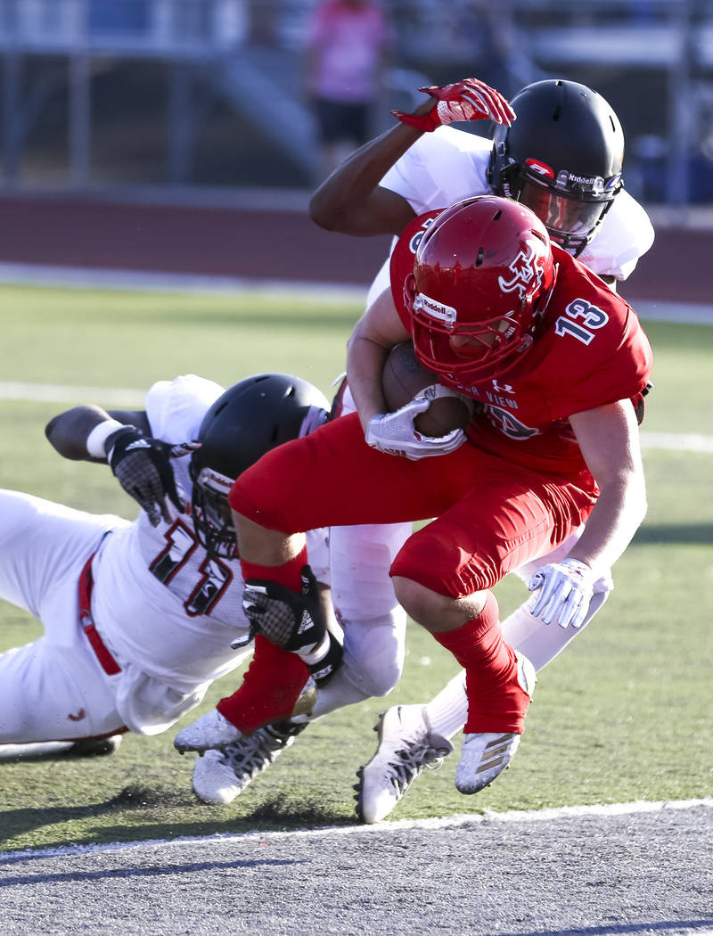 Arbor View Aggies running back/safety Justin Hausner (13) runs the ball into the end zone for a two-point conversion during the first half of a varsity football game against the Valley View Eagles ...