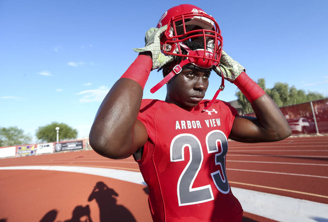 Arbor View Aggies running back/cornerback Darius Harrison (23) puts on his helmet before playing the Valley View Eagles of California in a varsity football game at Arbor View High School in Las Ve ...