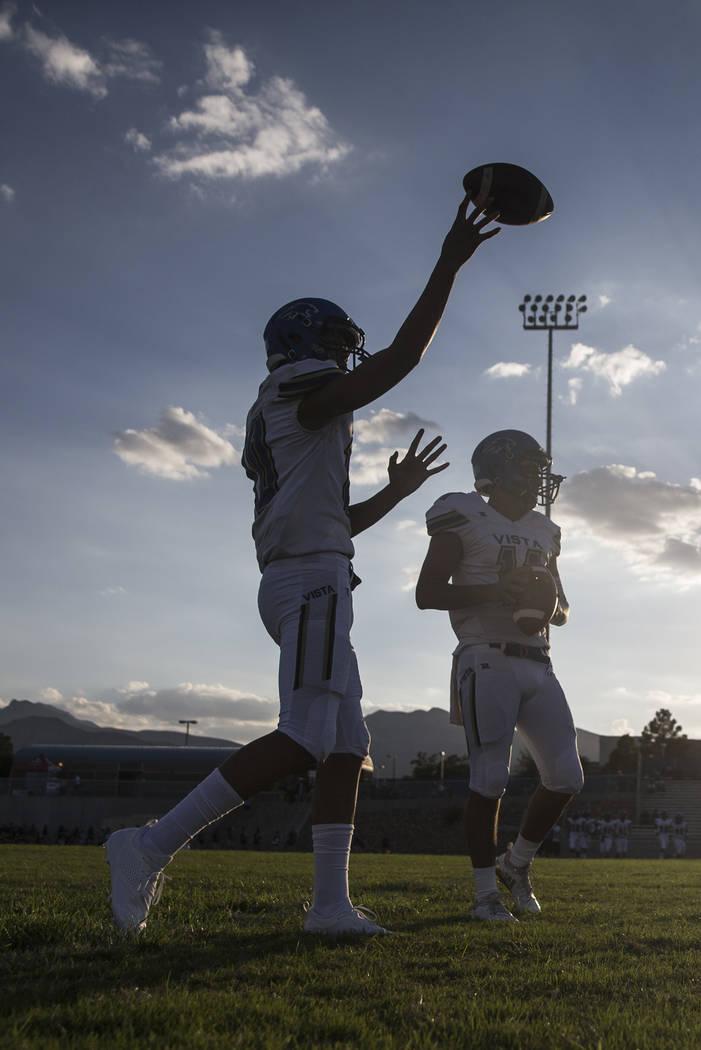 Sierra Vista senior quarterback Jordan Solomon (11) warms up before the start of the Mountain Lions road matchup with Centennial High School on Friday, Aug. 17, 2018, at Centennial High School, in ...