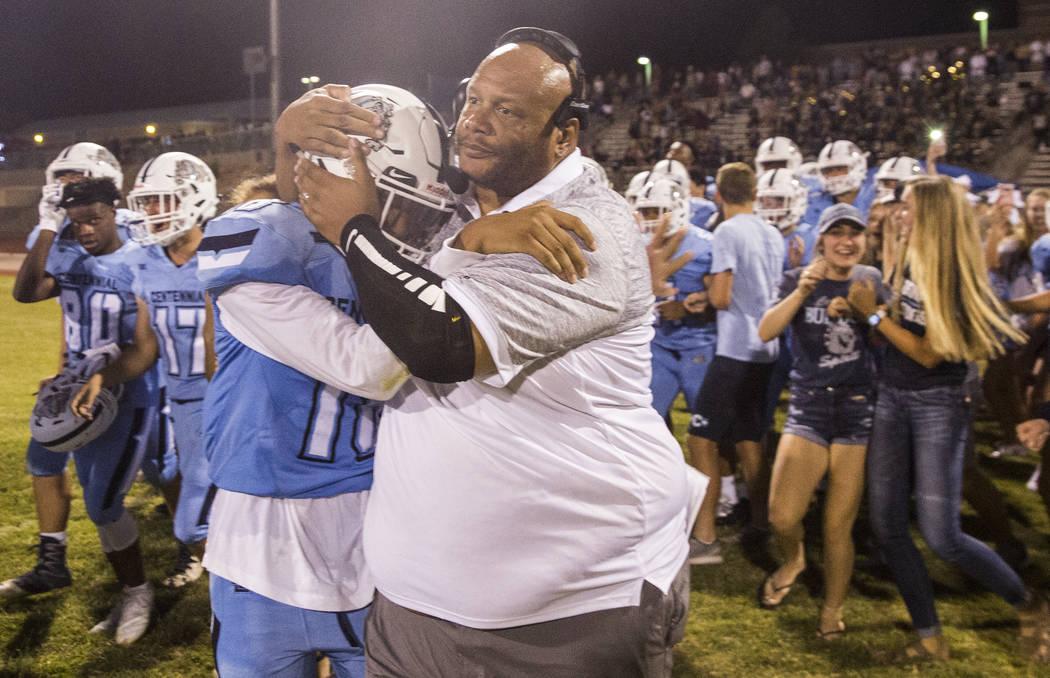 Centennial coach Stan Standifer hugs junior Trov Miller after the Bulldogs completed a dramatic fourth quarter comeback against Sierra Vista High School on Friday, Aug. 17, 2018, at Centennial Hig ...