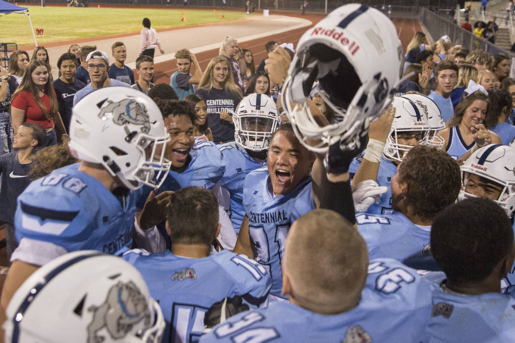 Centennial High School players celebrate after completing a dramatic fourth quarter comeback against Sierra Vista high School on Friday, Aug. 17, 2018, at Centennial High School, in Las Vegas. Ben ...