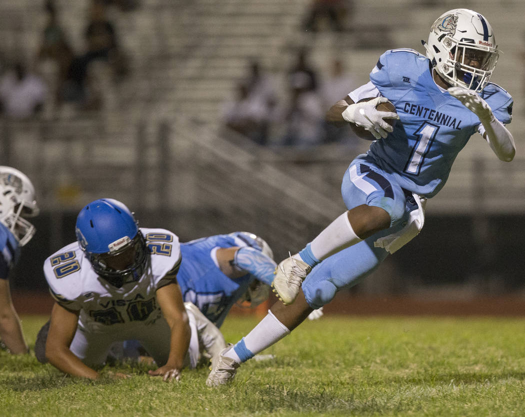 Centennial junior running back Jordan Smith (1) breaks through the line to score a two-point conversion against Sierra Vista High School in the fourth quarter on Friday, Aug. 17, 2018, at Centenni ...