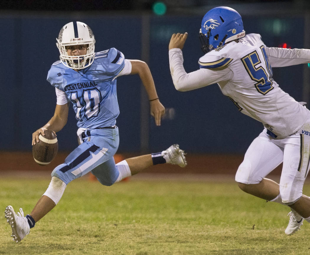 Centennial sophomore quarterback Colton Tenney (10) scrambles away from Sierra Vista junior defensive end Davion Hodges (54) in the fourth quarter on Friday, Aug. 17, 2018, at Centennial High Scho ...