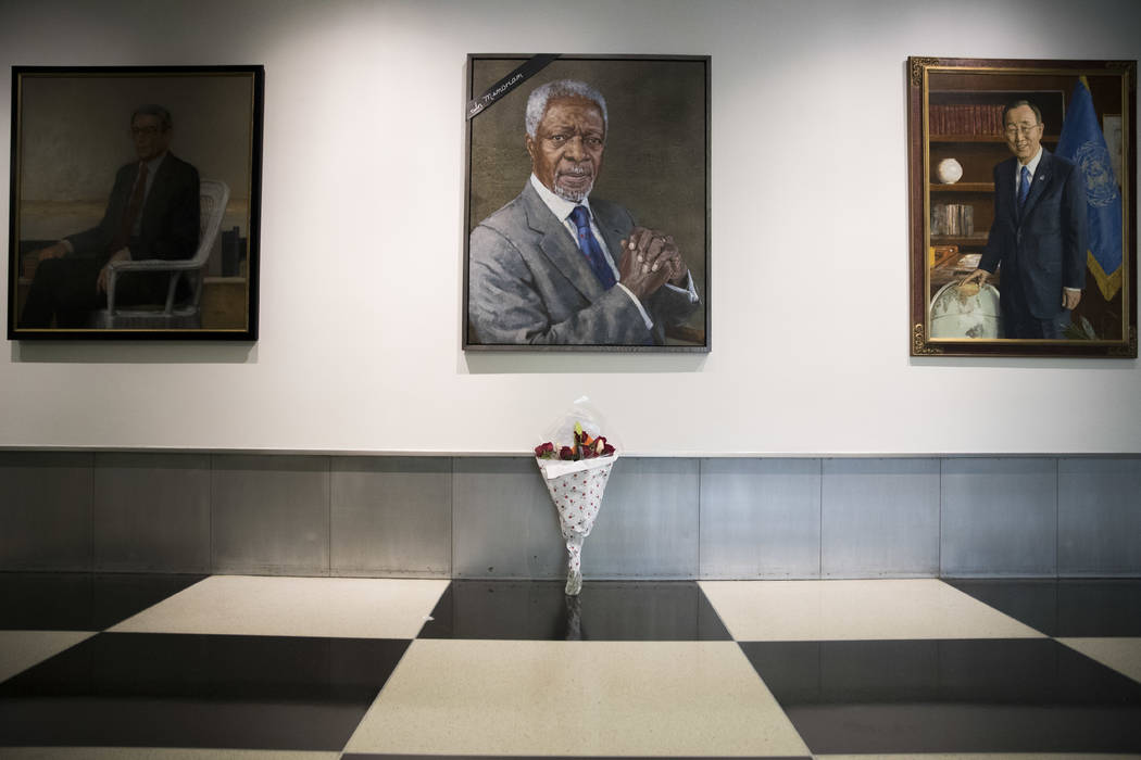 A black ribbon and a bouquet of flowers adorn the portrait of former United Nations Secretary-General Kofi Annan at U.N. headquarters, Saturday, Aug. 18, 2018. Annan, one of the world's most celeb ...