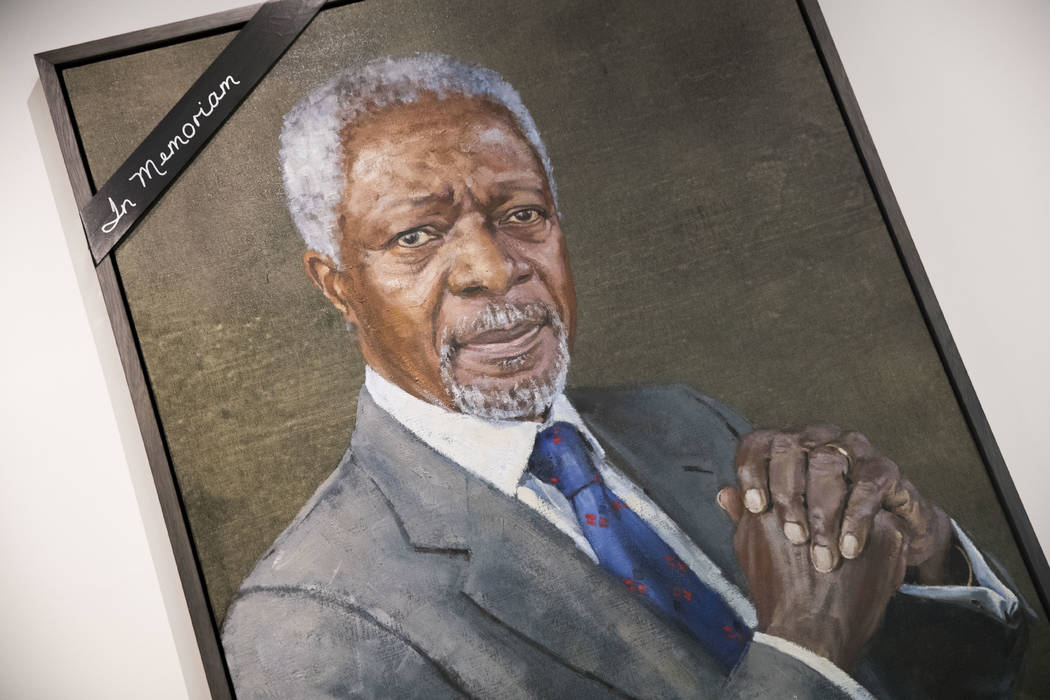 A black ribbon adorns the portrait of former United Nations Secretary-General Kofi Annan at U.N. headquarters, Saturday, Aug. 18, 2018. Annan, one of the world's most celebrated diplomats and a ch ...