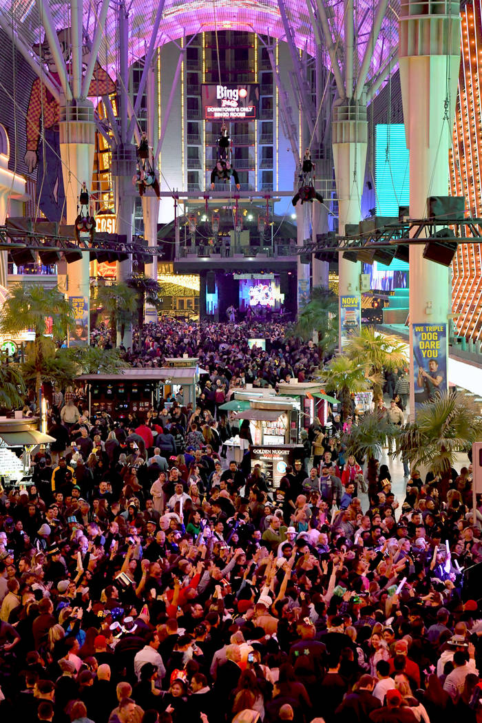 """""""America's Party 2018,"""" the fireworks and entertainment extravaganza, rang in the New Year at the Fremont Street Experience in downtown Las Vegas in 2017. (Glenn Pinkerton/Las Vegas News Bureau)"""