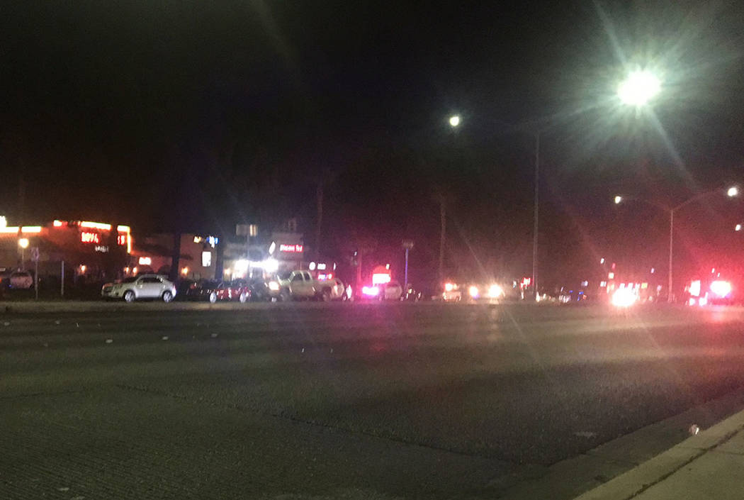 Las Vegas police investigate an officer-involved shooting at Sahara Avenue and Durango Drive on Saturday, Aug. 18, 2018. (Kimber Laux/Las Vegas Review-Journal)