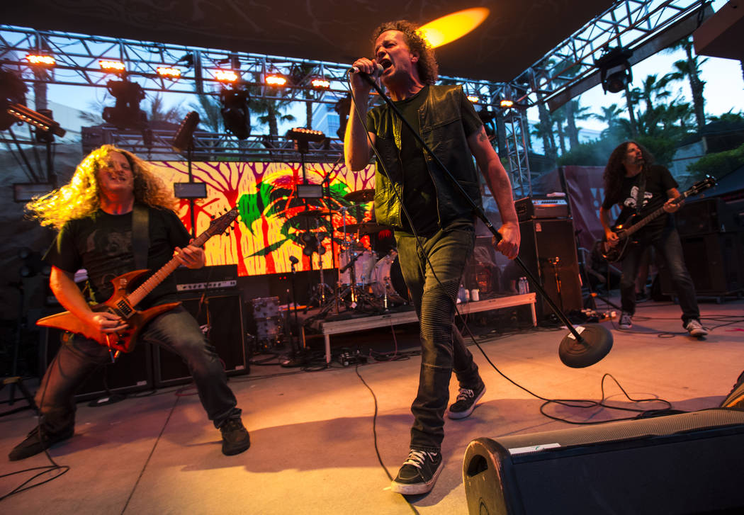 Daniel Mongrain, left, and Denis Belanger of Voivod perform at the pool stage during Psycho Las Vegas at the Hard Rock Hotel in Las Vegas on Saturday, Aug. 18, 2018. Chase Stevens Las Vegas Review ...