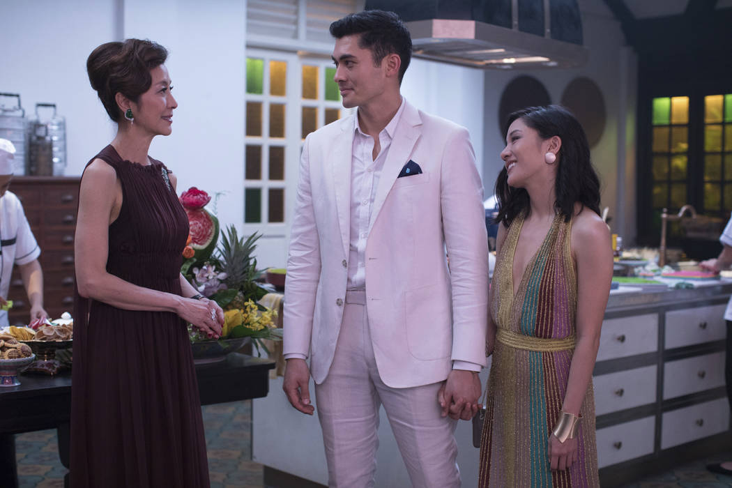 "This image released by Warner Bros. Entertainment shows Michelle Yeoh, from left, Henry Golding and Constance Wu in a scene from the film ""Crazy Rich Asians."" (Sanja Bucko/Warner Bros. E ..."