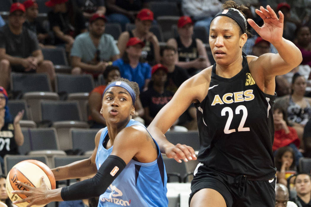 Las Vegas Aces center A'ja Wilson (22) tries to defend against Atlanta Dream shooting guard Tiffany Hayes (15) during the first half of a WNBA basketball game at the Mandalay Bay Events Center in ...