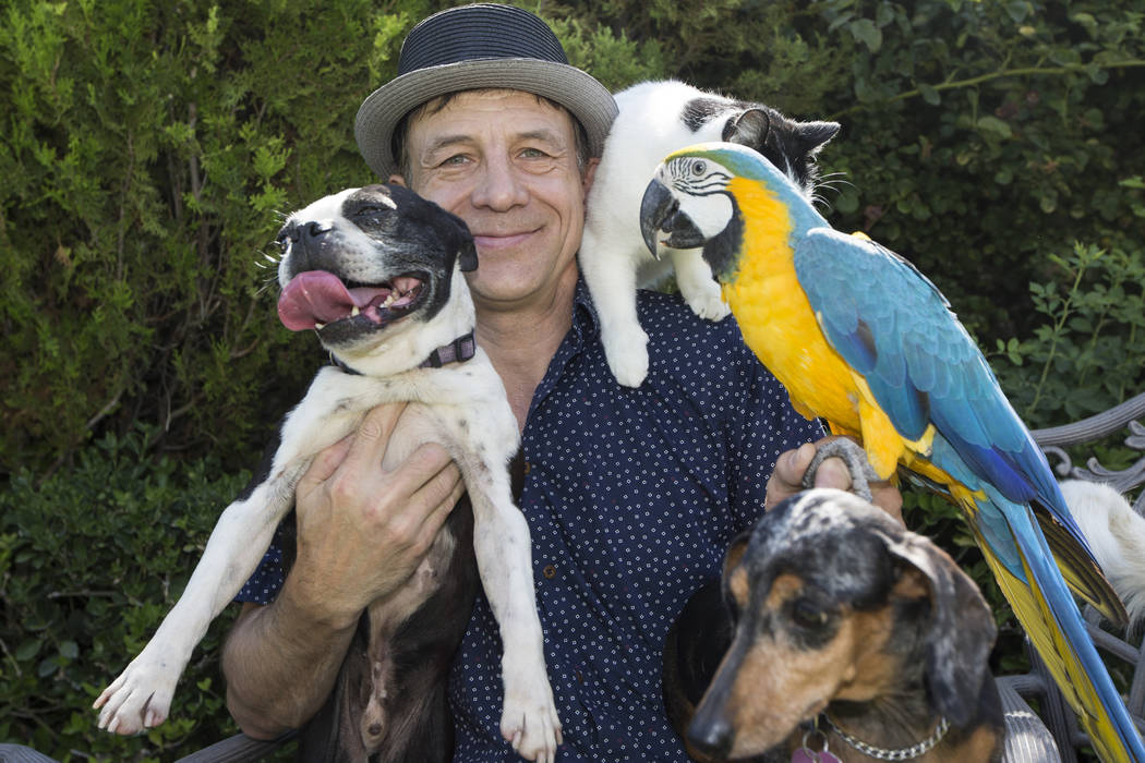 Gregory Popovich, host of The World Famous Popovich Comedy Pet Theater, poses for a photo with his pets at his North Las Vegas home June 24. Erik Verduzco/View Follow @Erik_Verduzco on Twitter