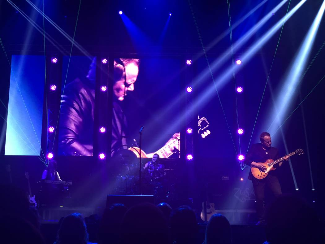 """John Wedemeyer is shown during """"Zeppelin USA: An American Tribute to Led Zeppelin"""" at Reynolds Hall at the Smith Center for the Performing Arts on Friday, Aug. 17, 2018. (John Katsilometes/Las ..."""