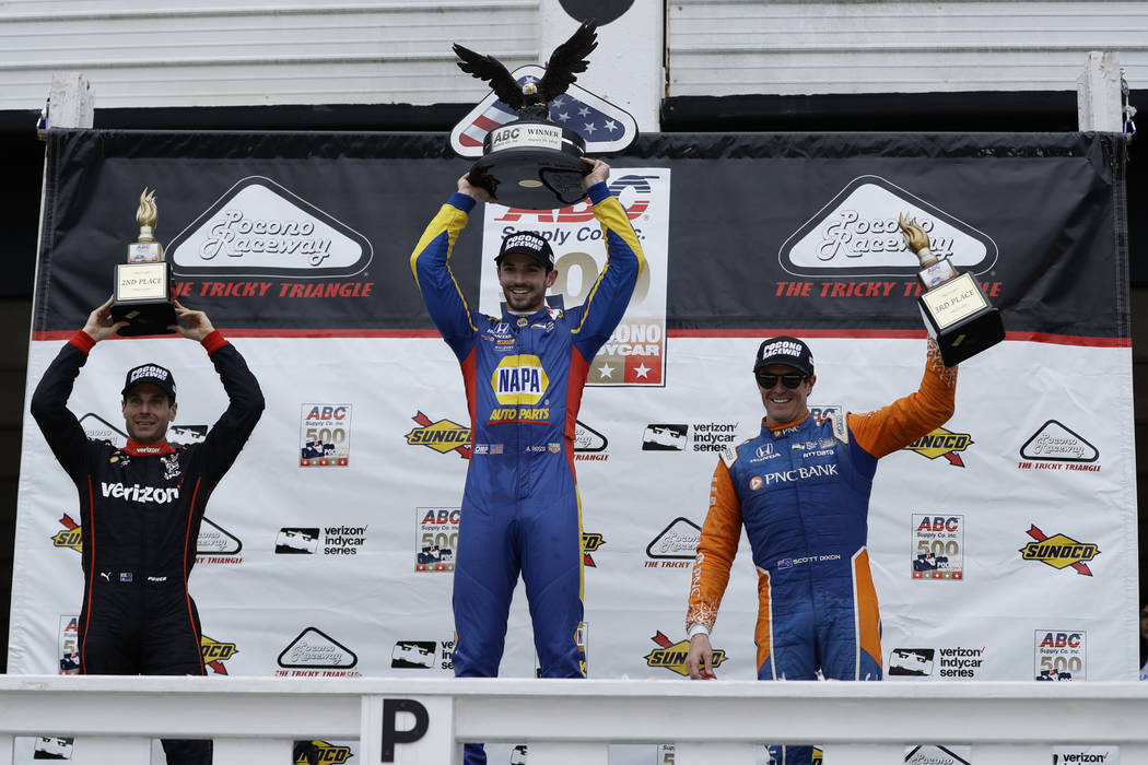 Alexander Rossi (27) celebrates after winning the IndyCar auto race at Pocono Raceway, Sunday, Aug. 19, 2018, in Long Pond, Pa. (AP Photo/Matt Slocum)