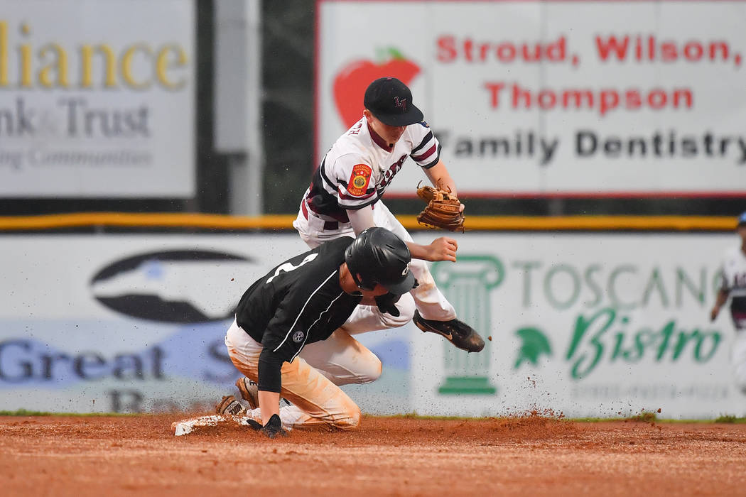 Dawson Painter of Asheboro, N.C., Randolph County Post 45 (black jersey,) collides with Las Vegas, Nev., Post 40's ColbySmith at second amidst a successful double play at Veterans Field at Keete ...