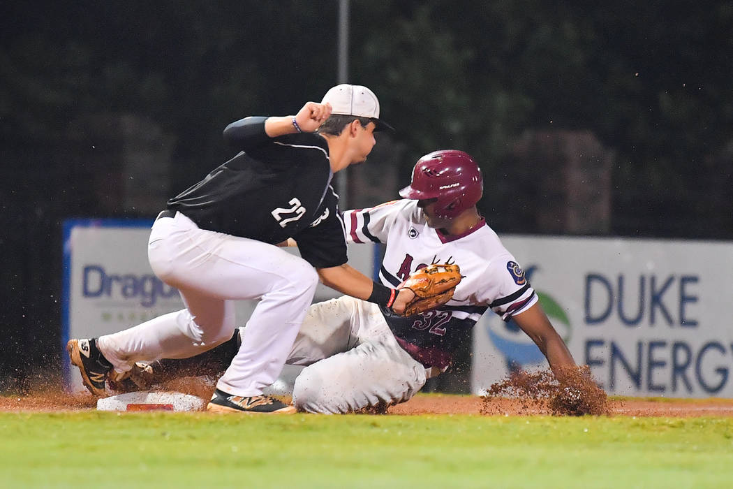 Edarian Williams slides safely into third base after hitting a triple for Las Vegas, Nev., Post 40 at Veterans Field at Keeter Stadium in Shelby, N.C., on Sunday, Aug. 19, 2018 during game 12 of t ...
