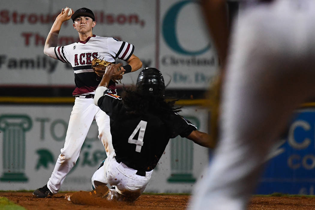 ColbySmith of Las Vegas, Nev., Post 40 throws over Asheboro, N.C., Randolph County Post 45's TrevorMarsh to complete a double play in the bottom of the second inning at Veterans Field at Keete ...