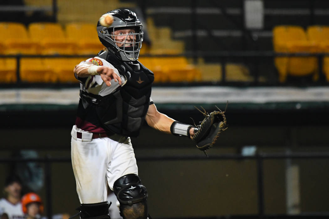 Las Vegas, Nev., Post 40's ParkerSchmidt scoops a bunted ball and picks up the out at the top of the third inning at Veterans Field at Keeter Stadium in Shelby, N.C., on Sunday, Aug. 19, 2018 du ...