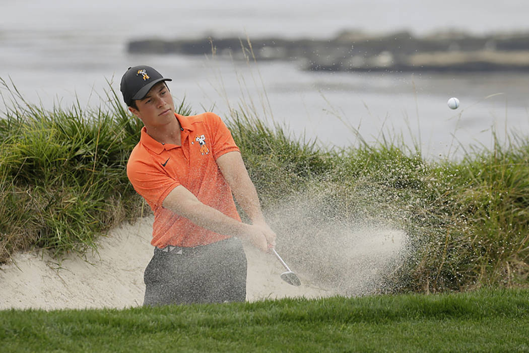 Viktor Hovland, of Norway, follows his shot out of a bunker onto the fourth green of the Pebble Beach Golf Links during the final round of the USGA Amateur Golf Championship against Devon Bling Su ...