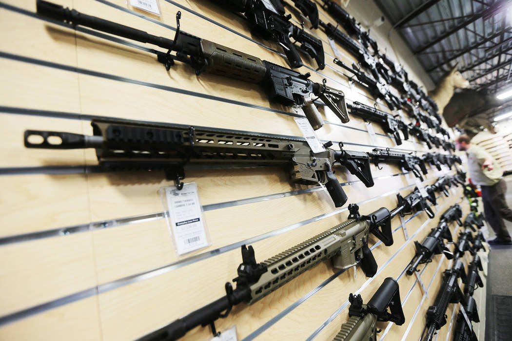A wall of AR-15 rifles (AP)
