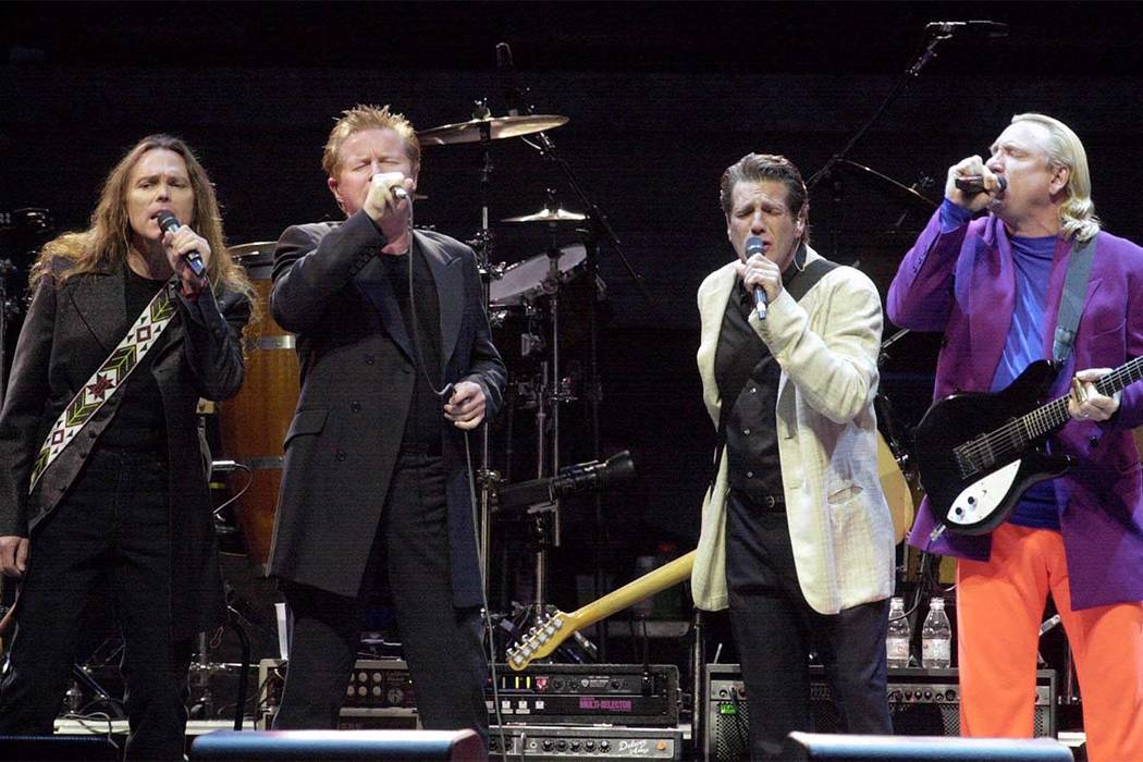 The Eagles, from left, Timothy B. Schmidt, Don Henley, Glenn Frey, and Joe Walsh perform on stage at Invesco Field during the first event to be held at the new stadium Saturday, Aug. 11, 2001, in ...