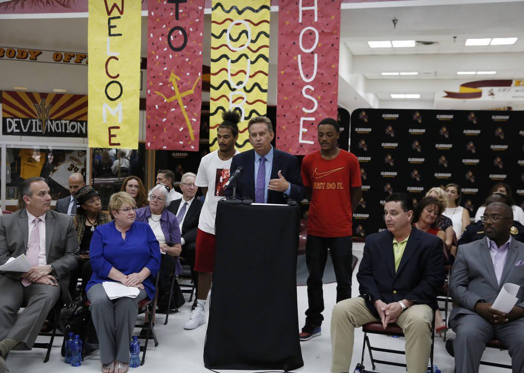 Eldorado High School Principal David Wilson speaks as Ryan Johnson, left, and Royale Davis, both Eldorado High graduates, look on during a press conference on Friday, Aug. 24, 2018, announcing a n ...