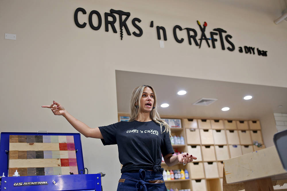 Owner Alainah Paul leads a Wine Sign Wednesdays class at Corks 'n Crafts in Las Vegas, Wednesday, Aug. 15, 2018. Corks 'n Crafts holds classes for home decor, painted wood signs, string art, fabr ...