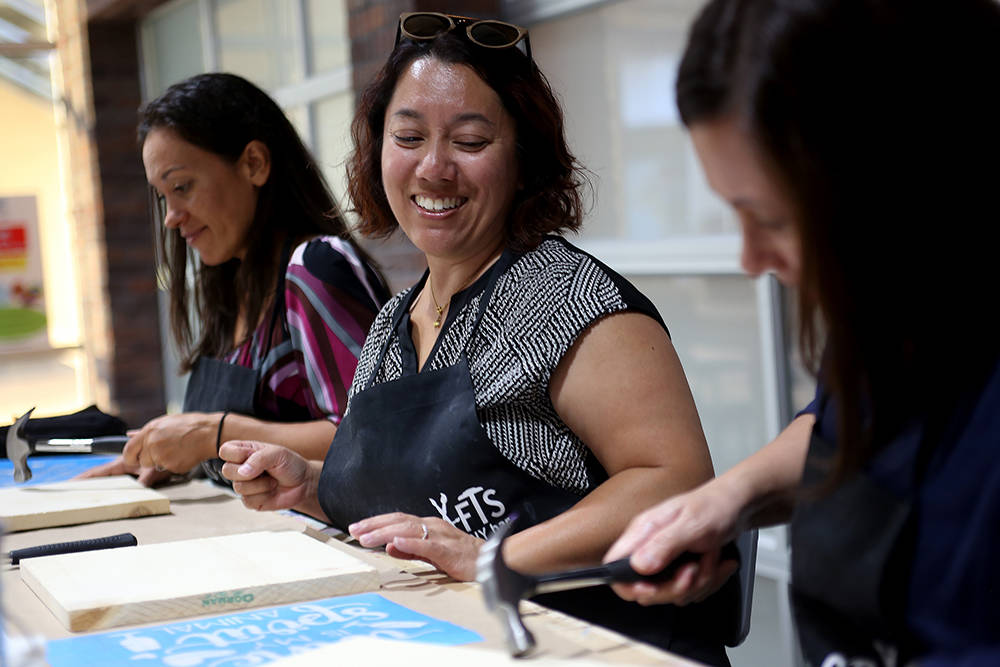 Friends Jessica Day, from left, Michelle Jenkins, and Lynn Manansala work on their wooden signs at a Wine Sign Wednesdays class at Corks 'n Crafts in Las Vegas, Wednesday, Aug. 15, 2018. Corks 'n ...