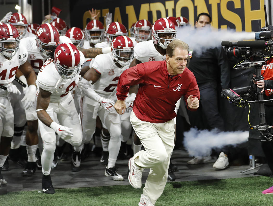 In this Jan. 8, 2018, file photo, Alabama head coach Nick Saban leads his team on the field before the NCAA college football playoff championship game against Georgia, in Atlanta. The AP preseason ...