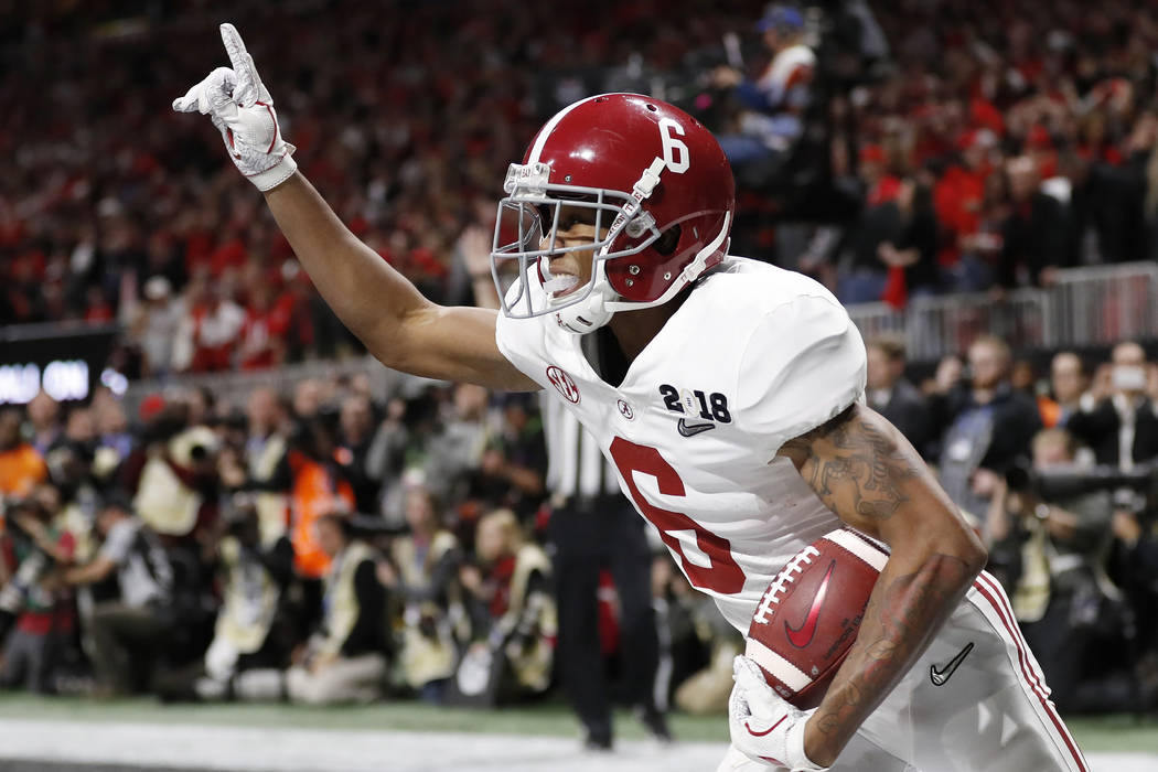 In this Jan. 8, 2018, file photo, Alabama wide receiver DeVonta Smith (6) celebrates his touchdown during overtime of the NCAA college football playoff championship game against Georgia, in Atlant ...