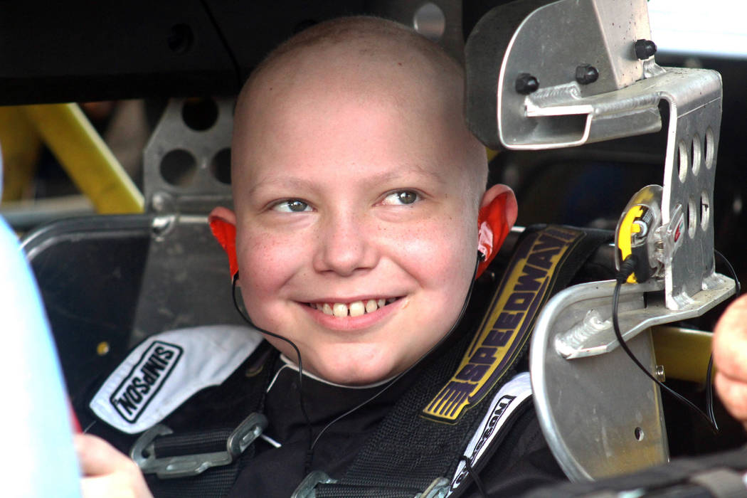 Caleb Hammond, an 11-year-old Iowa boy who wants racing stickers to cover his casket after he dies from leukemia, grins before heading out in a stock car designed for children on the Southern Iowa ...