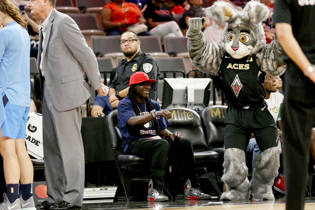 Flavor Flav dances with mascot Bucket$ at the final game of the season for Las Vegas Aces at the Mandalay Bay Events Center in Las Vegas, Sunday, Aug. 19, 2018. Atlanta Dream won 93-78. Rachel Ast ...