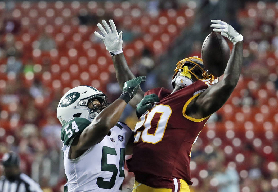 New York Jets linebacker Avery Williamson (54) breaks up a pass intended for Washington Redskins running back Rob Kelley (20) during the first half of a preseason NFL football game Thursday, Aug. ...