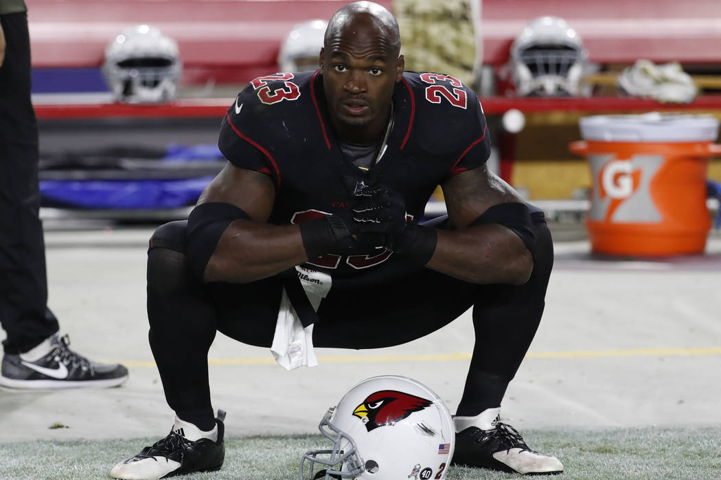 In this Nov. 9, 2017 file photo Arizona Cardinals running back Adrian Peterson (23) watches at the sideline during an NFL football game against the Seattle Seahawks in Glendale, Ariz. (AP Photo/Ri ...