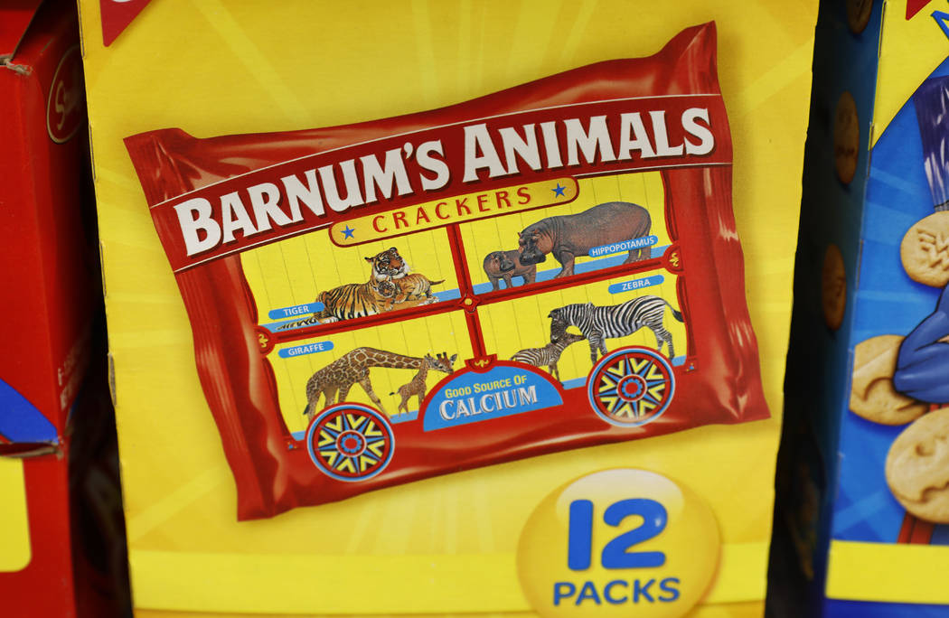 This Monday, Aug. 20, 2018, photo shows a multi-pack box of Nabisco Barnum's Animals crackers on the shelf of a local grocery store in Des Moines, Iowa. After more than a century behind bars, the ...