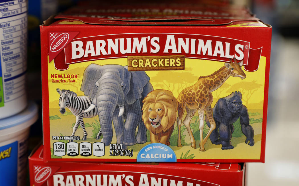 This Monday, Aug. 20, 2018, photo shows a box of Nabisco Barnum's Animals crackers on the shelf of a local grocery store in Des Moines, Iowa. Mondelez International says it has redesigned the pack ...